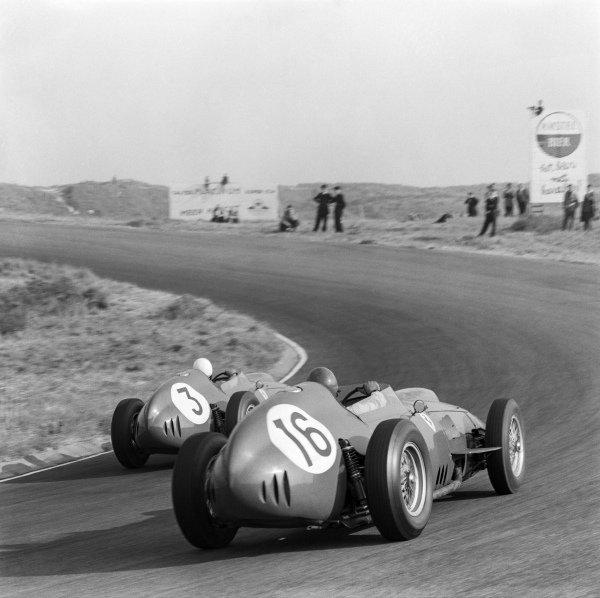 1959 Dutch Grand Prix. Zandvoort, Holland. 29 - 31 May 1959. Phil Hill, Ferrari Dino 246, 6th position leads Cliff Allison, Ferrari Dino 246, 9th position, action. World Copyright: LAT Images. Ref: 4116