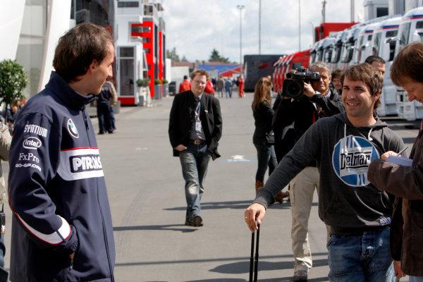 Nurburgring, Germany9th July 2009Robert Kubica, BMW Sauber F1 09 and Timo Glock, Toyota TF109 talk in the paddock.World Copyright: Glenn Dunbar/LAT Photographicref: Digital Image _3GD4536