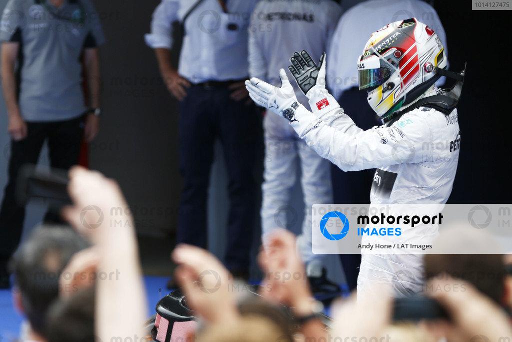 Circuit de Catalunya, Barcelona, Spain. Sunday 11 May 2014. Lewis Hamilton, Mercedes AMG, 1st Position, celebrates in Parc Ferme. World Copyright: Andy Hone/LAT Photographic. ref: Digital Image _ONZ1829
