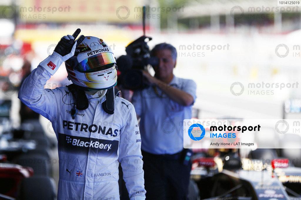 Circuit de Catalunya, Barcelona, Spain. Saturday 10 May 2014. Lewis Hamilton, Mercedes AMG, celebrates pole in Parc Ferme. World Copyright: Andy Hone/LAT Photographic. ref: Digital Image _ONZ0873