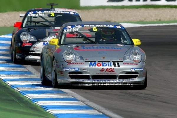 Pierre Kaffer (GER) Infineon - Team Farnbacher leads Wolf Henzler (GER) Aqua Nova Racing Team Kadach.Porsche Supercup, Rd8, Hockenheim, Germany,3 August 2003.DIGITAL IMAGE