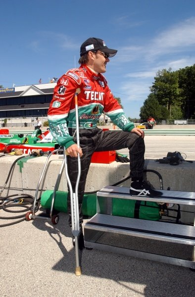 CART FedEx Championship Series.Grand Prix of Road America, Round 12August  16-18, 2002.Elkhart Lake, Wisconsin, USAAdrian Fernandez (MEX) returns to race aided by a crutch after his accident in Vancouver.Digital Image