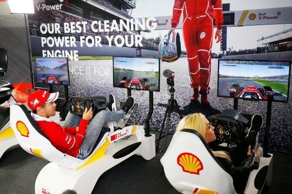 Silverstone, Northamptonshire, UK.  Thursday 13 July 2017. Sebastian Vettel, Ferrari, plays a computer game. World Copyright: Andy Hone/LAT Images  ref: Digital Image _ONZ2790