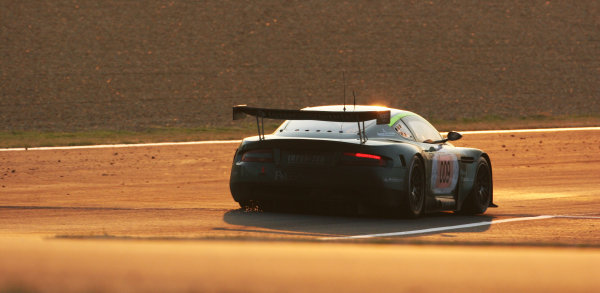Le Mans, France.14th - 18th June. Stephane Sarrazin / Pedro Lamy / Stephane Ortelli, Aston Martin. Action. Sunrise. World Copyright:Kevin Wood/LAT PhotographicRef: Digital Image Only. IMG_3876a
