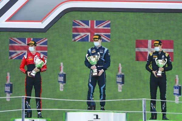 Callum Ilott (GBR, UNI-VIRTUOSI), Race Winner Dan Ticktum (GBR, DAMS) and Christian Lundgaard (DNK, ART GRAND PRIX) on the podium with the trophy