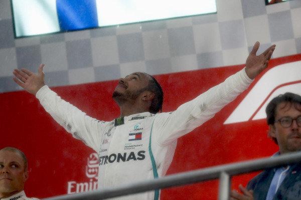 Lewis Hamilton, Mercedes AMG F1, and Valtteri Bottas, Mercedes AMG F1, celebrate on the podium.