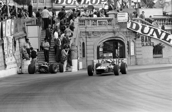Lorenzo Bandini, Ferrari 312, passes Jim Clark's retired Lotus 33 Climax.