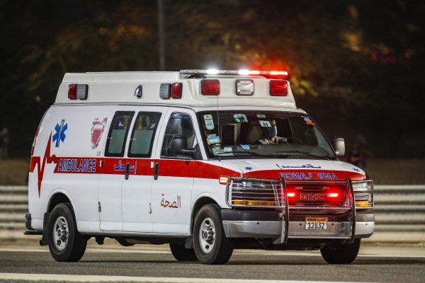 An ambulance drives Romain Grosjean, Haas F1, to the circuit medical centre