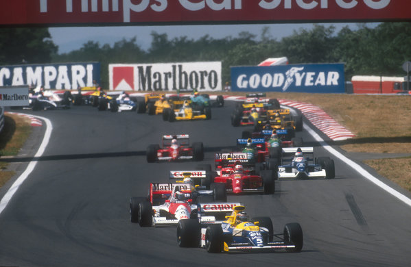 1990 Hungarian Grand Prix.Hungaroring, Budapest, Hungary.10-12 August 1990.Thierry Boutsen (Williams FW13B Renault) leads Gerhard Berger (McLaren MP4/5B Honda), Riccardo Patrese (Williams FW13B Renault), Nigel Mansell (Ferrari 641), Ayrton Senna (McLaren MP4/5B Honda), Jean Alesi (Tyrrell 019 Ford), Alessandro Nannini (Benetton B190 Ford), Andrea de Cesaris (Dallara 190 Ford) and Nelson Piquet (Benetton B190 Ford) at the start.Ref-90 HUN 01.World Copyright - LAT Photographic