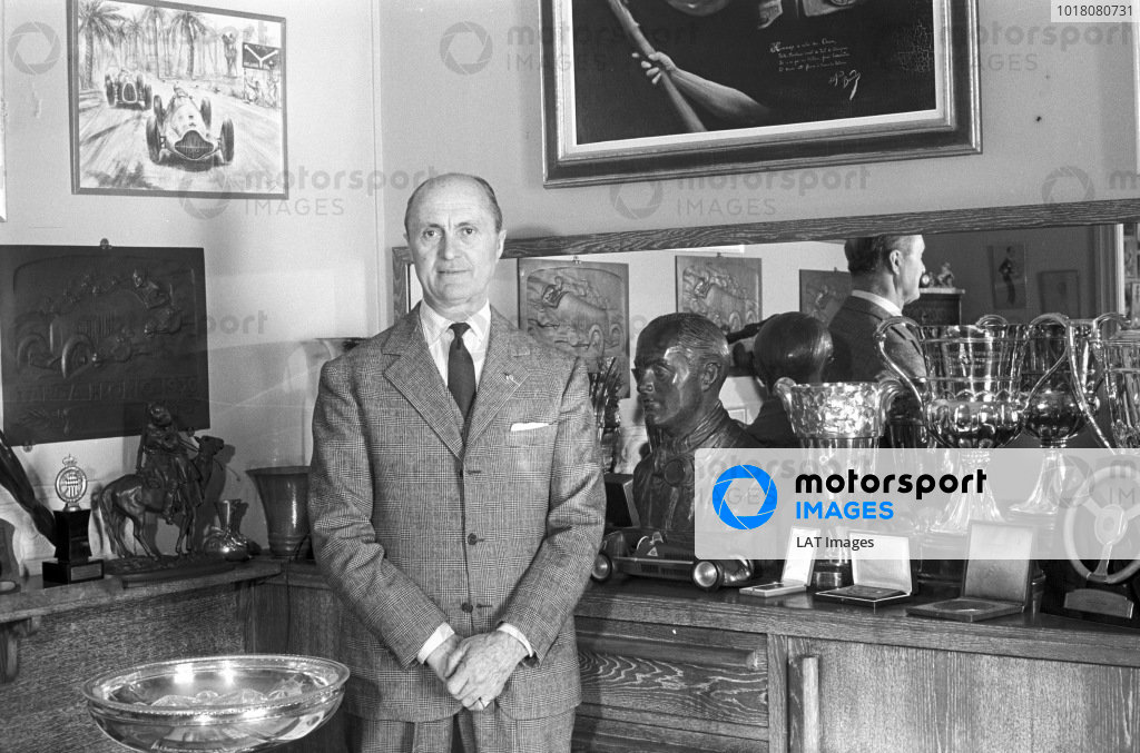 Louis Chiron surrounded by trophies.