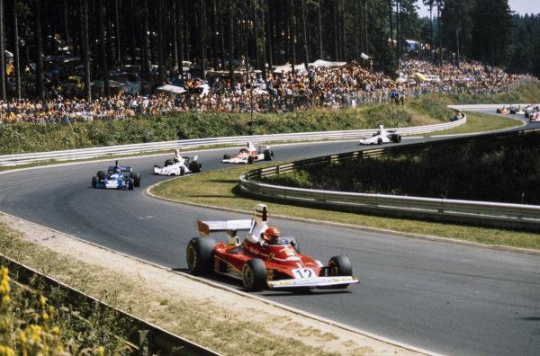 Niki Lauda, Ferrari 312T leads Patrick Depailler, Tyrrell 007 Ford and Carlos Pace, Brabham BT44B Ford.