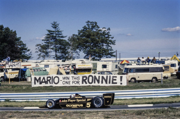 Mario Andretti, Lotus 79 Ford drives past a banner from a fan. Ronnie Peterson had died at the recent Italian Grand Prix at Monza.
