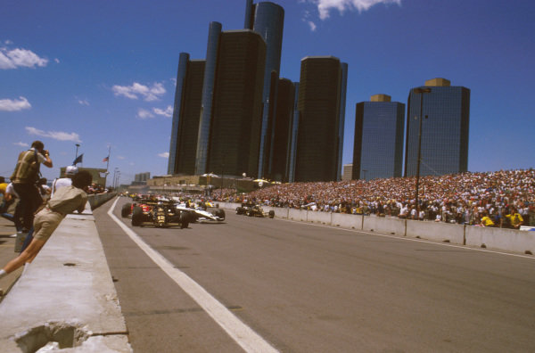 Detroit, Michigan, USA.22-24 June 1984.Nigel Mansell (Lotus 95T Renault) glances poleman Nelson Piquet's (Brabham BT53 BMW) quite heavily, causing him to crash at the start. This also caused Alboreto and Surer to go out as well. The race was immediately red flagged.Ref-84 USA 02.World Copyright - LAT Photographic