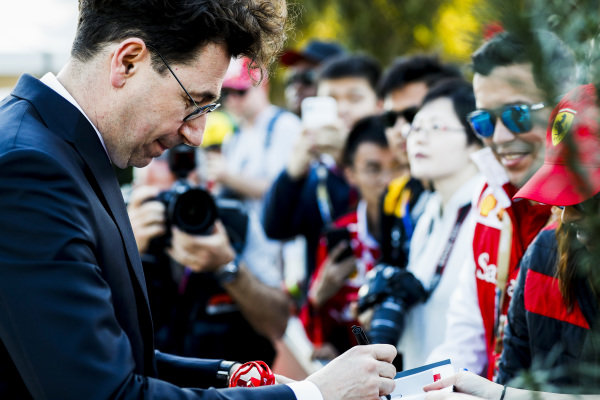 Mattia Binotto, Team Principal Ferrari signs an autograph for a fan