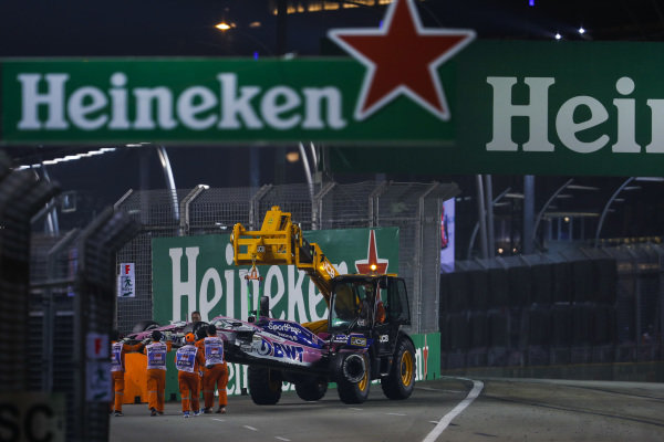 Marshals remove the car of Sergio Perez, Racing Point RP19, from the circuit
