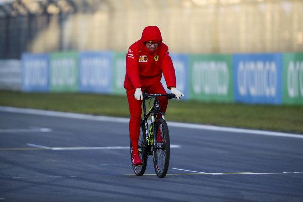 Mattia Binotto, Team Principal Ferrari walks the track on a bike