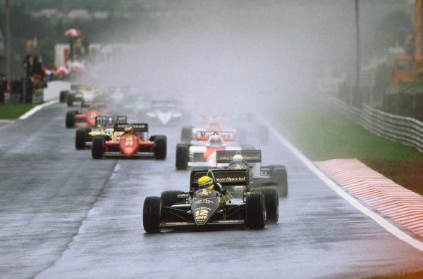 Estoril, Portugal.19-21 April 1985.Ayrton Senna leads teammate Elio de Angelis (both Lotus 97T Renault's), Alain Prost (McLaren MP4/2B TAG Porsche) and Michele Alboreto (Ferrari F156/85) at the start, action.World Copyright - LAT Photographic