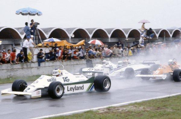 1981 Brazilian Grand Prix.Jacarepagua, Rio de Janeiro, Brazil. 27-29 March 1981.Carlos Reutemann (Williams FW07C-Ford Cosworth) leads Riccardo Patrese (Arrows A3-Ford Cosworth), Nelson Piquet (Brabham BT49C-Ford Cosworth) and Alan Jones (Williams FW07C-Ford Cosworth) at the start. Reutemann finished in 1st position.World Copyright: LAT PhotographicRef: 35mm transparency 81BRA10