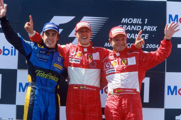2004 French Grand PrixMagny-Cours, France. 2nd - 4th JulyMichael Schumacher, Ferrari F2004 Fernando Alonso, Renault R24 and Rubens Barrichello, Ferrari F2004 celebrate on the podium.World Copyright: LAT PhotographicRef:35mm Image A04