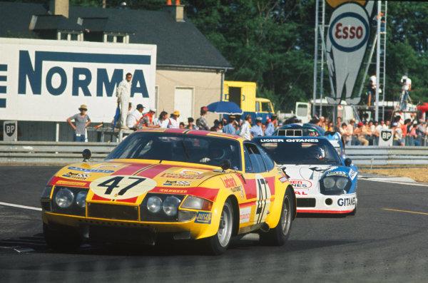 Le Mans, France. 14-15 June 1975 Jean-Claude Andruet/Teddy Pilette/Hughes de Fierlandt (Ferrari 365 GTB/4), 12th position, leads Jean-Louis Lafosse/Guy Chasseuil (Ligier JS2 Ford), 2nd position, action. World Copyright: LAT PhotographicRef: 75LM14.