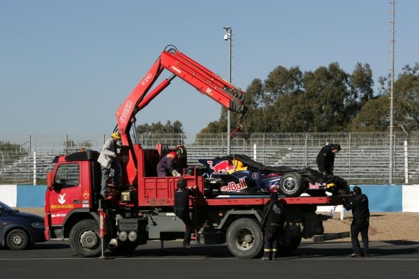 The car of Sebastian Vettel (GER) Red Bull Racing RB4 is taken back to the pits after he went off. Formula One Testing, Jerez, Spain, Tuesday 16 December 2008
