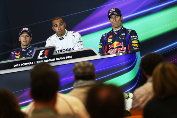 Spa-Francorchamps, Spa, Belgium. 24th August 2013. Lewis Hamilton, Mercedes AMG, Sebastian Vettel, Red Bull Racing, and Mark Webber, Red Bull Racing, in the post qualifying Press Conference. World Copyright: Sam Bloxham/LAT Photographic. ref: Digital Image BH2I0362.
