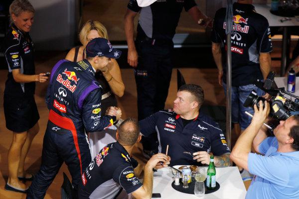 Marina Bay Circuit, Singapore. Saturday 21st September 2013. Sebastian Vettel, Red Bull Racing with members of his team in the paddock. World Copyright: Charles Coates/LAT Photographic. ref: Digital Image _N7T5521
