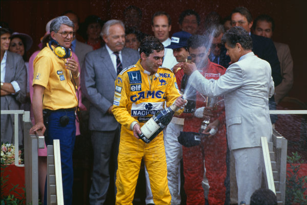 1987 Monaco Grand Prix. Monte Carlo, Monaco. 28th - 31st May 1987.  Ayrton Senna (Lotus 99T Honda),1st position, with Lotus boss Peter Warr ,who collected the constructors trophy, podium, portrait. World Copyright: LAT Photographic. Ref: 87MONh