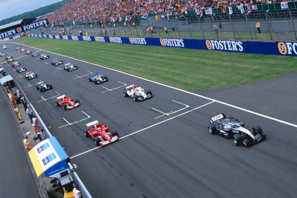 2004 British Grand Prix Silverstone England. 9th - 11th July. Kimi Raikkonen, McLaren Mercedes MP4/19 leads the field away at the start of the race. Action.  World Copyright:Steven Tee/LAT Photographi--c  Ref:35mm image A04