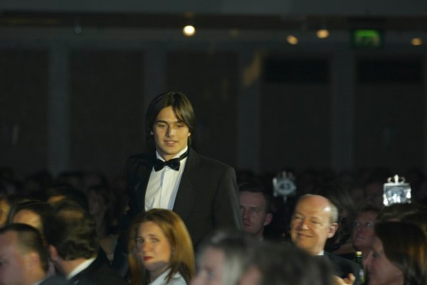2003 AUTOSPORT AWARDS, The Grosvenor, London. 7th December 2003.Nelson Piquet Jnr makes his way through the guests to receive the Paul Warwick trophy.Photo: Peter Spinney/LAT PhotographicRef: Digital Image only