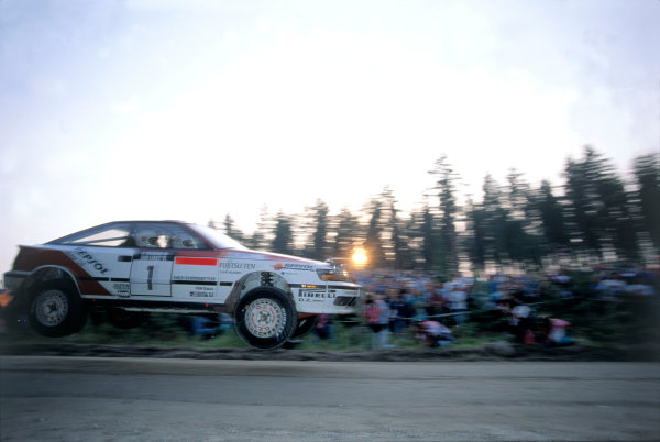 FIA World Rally Championship.1000 Lakes , Finland. 22nd - 25th August 1991.Carlos Sainz and Luis Moya get airborne their Toyota Celica GT4. Action. World Copyright:LAT Photographic.Ref:35mm Image