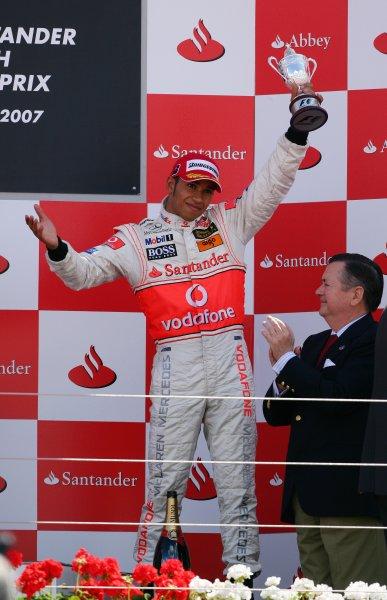 Silverstone, Northamptonshire, England.8th July 2007.Lewis Hamilton, McLaren MP4-22 Mercedes, 3rd position, celebrates on the podium. Portrait. Podiums.World Copyright: Steve Etherington/LAT Photographicref: Digital Image WI2T7413