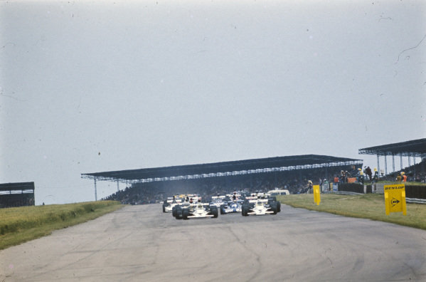 Team mates Peter Revson, McLaren M23 Ford and Denny Hulme, McLaren M23 Ford leading a group of cars, including Lotus 72D Ford team-mates Ronnie Peterson and Emerson Fittipaldi.