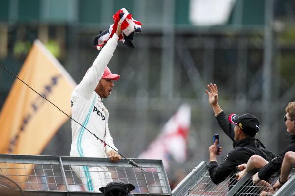 Race winner Lewis Hamilton, Mercedes AMG F1 celebrates with fans