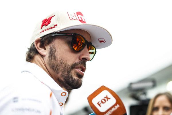 Fernando Alonso, McLaren, talks to the media