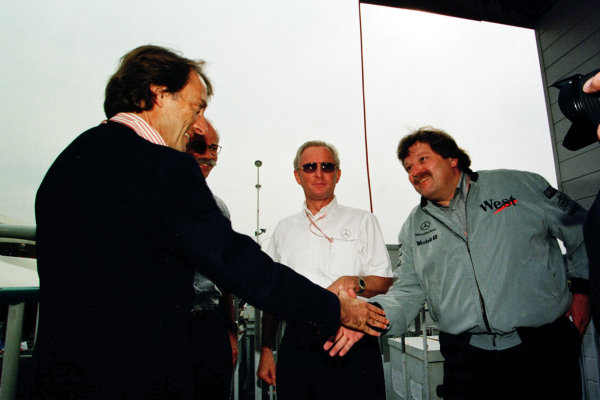 Japanese Grand Prix.Suzuka, Japan.30/10-1/11 1998.Luca di Montezemolo (Ferrari) congratulates Norbert Haug (Daimler-Benz) after winning the World Championship.World Copyright - Photo 4/LAT Photographic
