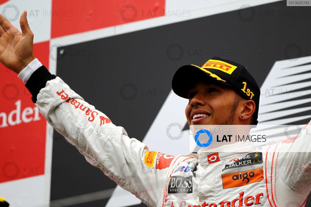 Nurburgring, Germany.24th July 2011Lewis Hamilton, McLaren MP4-26 Mercedes, 1st position, on the podium. Portrait. Podium. World Copyright: Andy Hone/LAT Photographicref: Digital Image CSP13411