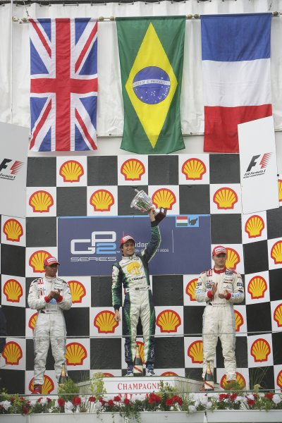 2006 GP2 Series Round 9. Hungaroring, Budapest, Hungary. 6th August 2006. Sunday race.Nelson Piquet Jr. (BRA, Piquet Sports) 1st, Lewis Hamilton (GBR, ART Grand Prix) 2nd, Alexandre Premat (FRA, ART Grand Prix) 3rd. Podium.World Copyright: Andrew Ferraro/GP2 Series Media Service. Ref: Digital Image Only.ZP9O0547 jpg
