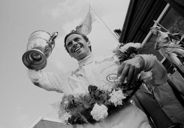 Jim Clark, 1st position, celebrates with the trophy.
