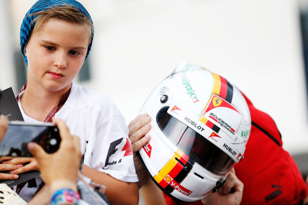 Hungaroring, Budapest, Hungary. Thursday 23 July 2015. A young fan waits to get a helmet signed by Sebastian Vettel, Ferrari. World Copyright: Charles Coates/LAT Photographic ref: Digital Image _J5R0815