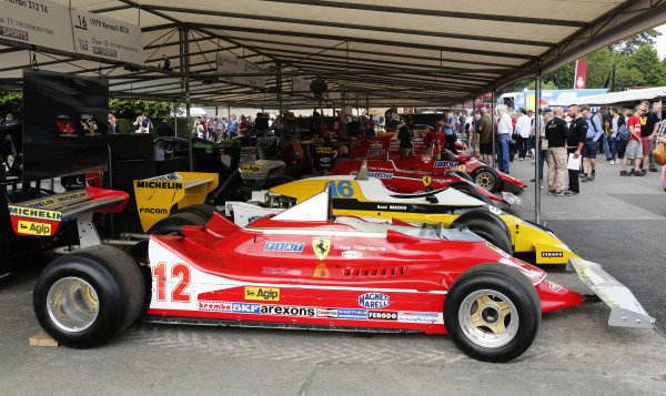 2015 Goodwood Festival of Speed.  Goodwood Estate, West Sussex, England. 25th - 28th June 2015.  Gilles Villeneuve's Ferrari 312T4 and Rene Arnoux's Renault RS10, parked as if to recreate their famous battle in the 1979 French Grand Prix.  Ref: KW5_3475a. World copyright: Kevin Wood/LAT Photographic