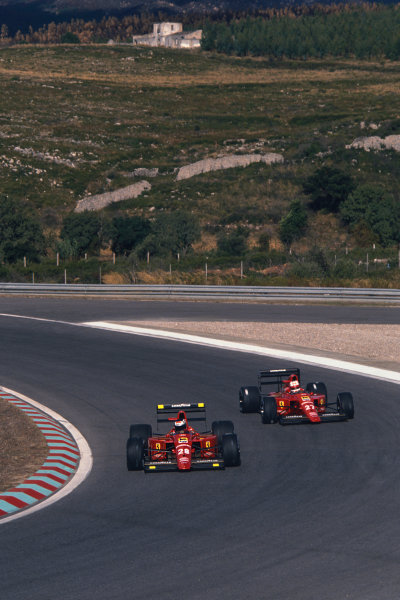 1989 Portuguese Grand Prix  Estoril, Portugal. 22-24 September 1989.  Gerhard Berger and Nigel Mansell, both Ferrari 640.  Ref: 89POR13. World copyright: LAT Photographic