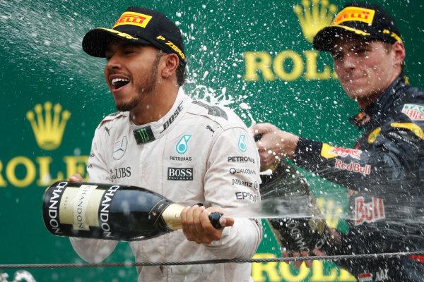 Interlagos, Sao Paulo, Brazil. Sunday 13 November 2016. Lewis Hamilton, Mercedes AMG, sprays champagne with Max Verstappen, Red Bull, on the podium. World Copyright: Glenn Dunbar/LAT Photographic ref: Digital Image _X4I8468