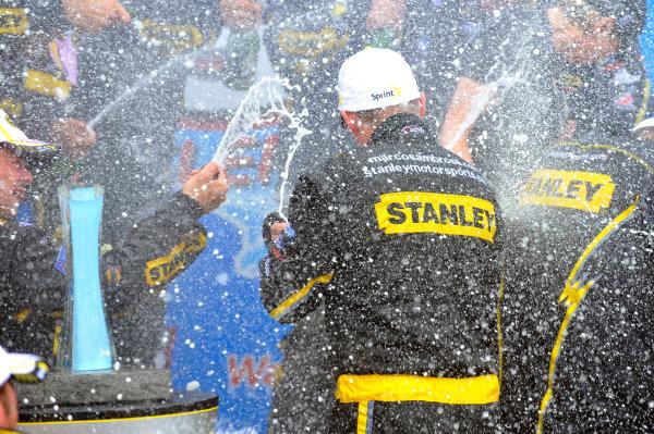 10-12 August, 2012, Watkins Glen, New York USAMarcos Ambrose celebrates his win in Victory Lane(c)2012, LAT SouthLAT Photo USA