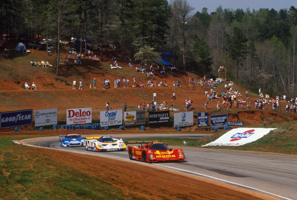 Road Atlanta 500 Kms, Georgia, USA. 1st April 1990. Rd 4. Gianpiero Moretti / Derek Bell (Porsche 962C), 4th position leads Kevin Cogan / John Paul, Jr (Nissan GTP ZX-T), 15th position, action. World Copyright: Bill Murenbeeld/LAT Photographic.  Ref:  90IMSA RAT01.
