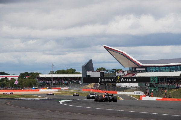 Silverstone, Northamptonshire, UK.  Sunday 16 July 2017. Lance Stroll, Williams FW40 Mercedes, leads Fernando Alonso, McLaren MCL32 Honda. World Copyright: Mauger/LAT Images  ref: Digital Image _56I1286