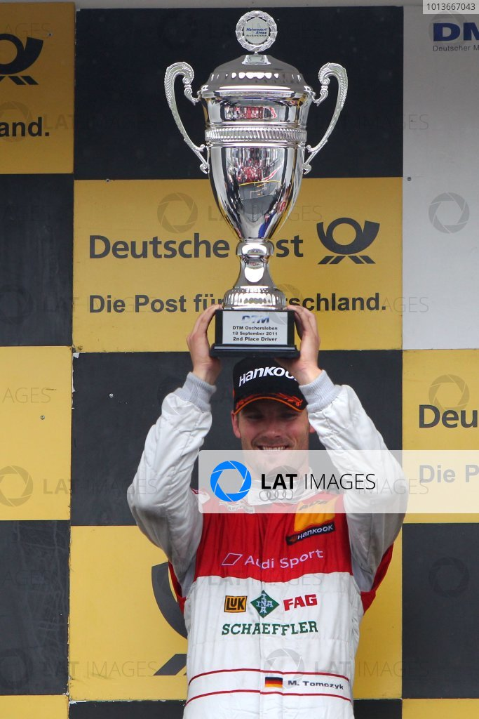 Martin Tomczyk (GER), Audi Sport Team Phoenix, Schaeffler Audi A4 DTM (2008), celebrates second place on the podium with his trophy.DTM, Rd8, Oschersleben, Germany, 16-18 September 2011 Ref: Digital Image dne1118se550