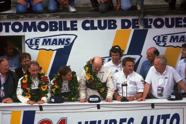 Le Mans, France. 16th - 17th June 1990. Price Cobb/Martin Brundle/John Neilsen (Jaguar XJR12), 1st position, with team manager Tom Walkinshaw, podium. World Copyright: LAT Photographic. Ref: 90LM19.