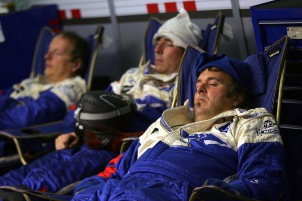 Peugeot mechanics get some well earned rest. Le Mans 24 Hours, La Sarthe, Le Mans, France, 13-14 June 2009.
