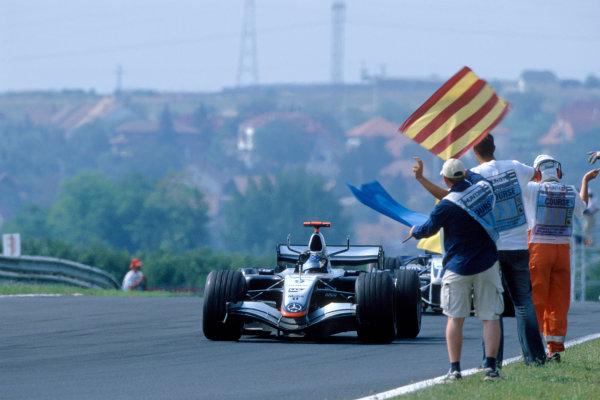 2005 Hungarian Grand Prix. Hungaroring, Hungary. 29th - 31st July 2005 Kimi Raikkonen, McLaren Mercedes MP4-20 celebrates victory. World Copyright: Glenn Dunbar/LAT Photographic Ref: 35mm Image A01